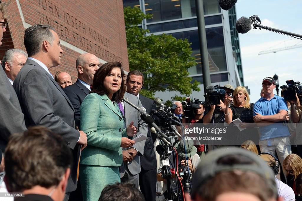 S Attorney Carmen Ortiz surrounded by prosecuting attorneys speaks to reporters outside the John Joseph Moakley United States Courthouse following a...