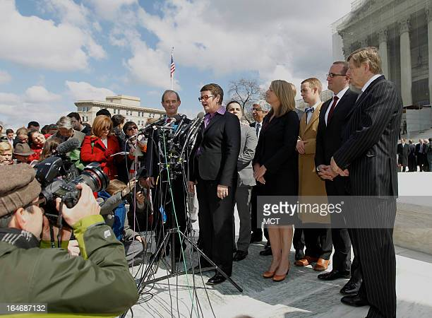 Attorney David Bois and Ted Olson listen as plaintiff Kris Perry speaks outside the US Supreme Court after California's Proposition 8 was argued...