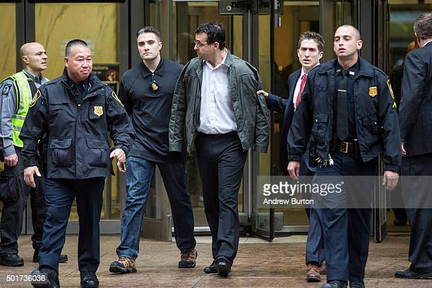 Attorney Evan Greebel is brought out of 26 Federal Plaza by law enforcement officials after being arrested as a codefendent with Turing...