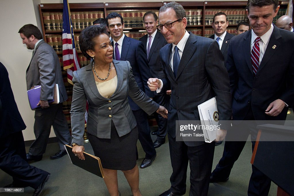 US Attorney for the Eastern District of New York Loretta Lynch, left, and Assistant US Attorney General <a gi-track='captionPersonalityLinkClicked' href=/galleries/search?phrase=Lanny+Breuer&family=editorial&specificpeople=2591883 ng-click='$event.stopPropagation()'>Lanny Breuer</a> smile as they leave a news conference to announce money laundering charges against HSBC on December 11, 2012 in the Brooklyn borough of New York City. HSBC Holdings plc and HSBC USA NA have agreed to pay $1.92 billion and enter into a deferred prosecution agreement with the U.S. Department of Justice in regards to charges involving money laundering with Mexican drug cartels.