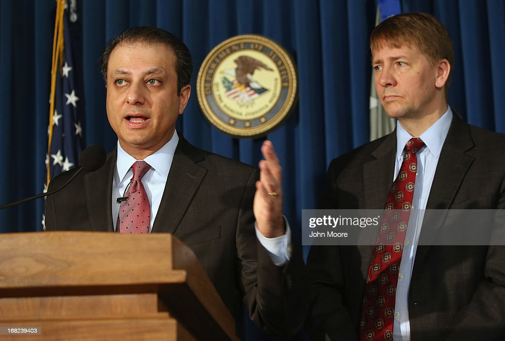 U.S. Attorney for the Southern District of New York Preet Bharara (L), and Director of the Consumer Financial Protection Bureau Richard Cordray address the media on May 7, 2013 in New York City. Bharara announced an indictment that charged leaders of the Mission Settlement Agency with mail and wire fraud in a scheme that allegedly victimized 1,200 debters in a multi-million dollar scheme. The case was the first referral from the new Consumer Financial Protection Bureau.