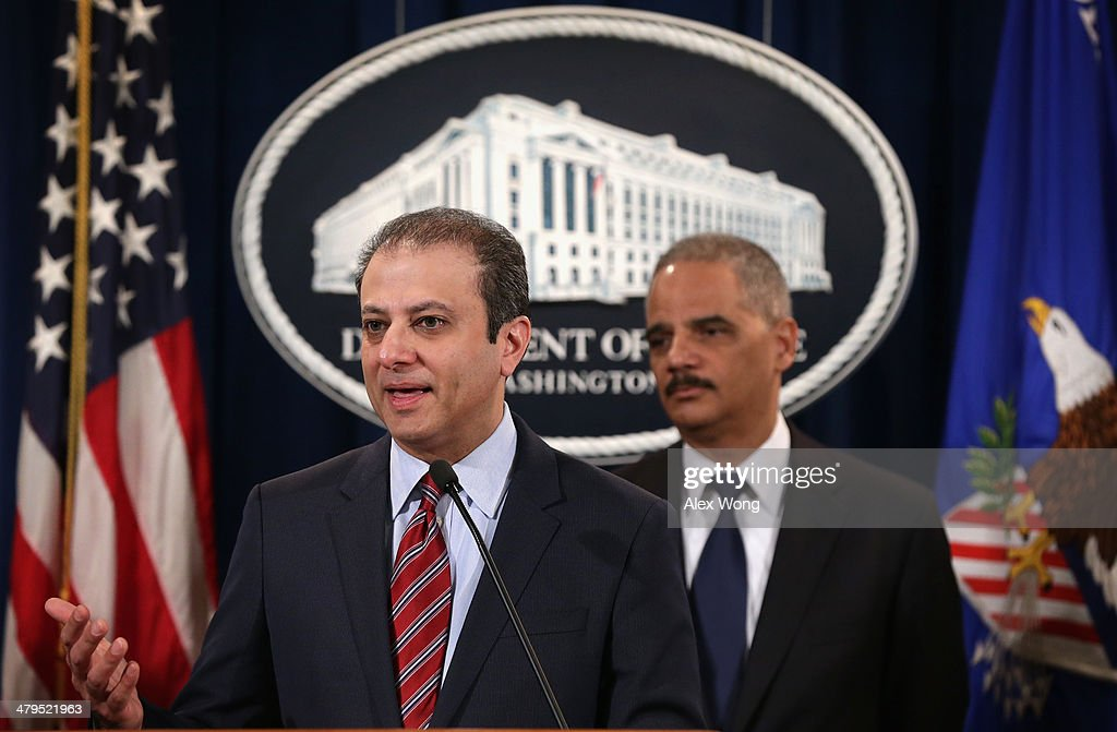 S Attorney for the Southern District of New York Preet Bharara speaks as US Attorney General Eric Holder listens during an announcement at the...