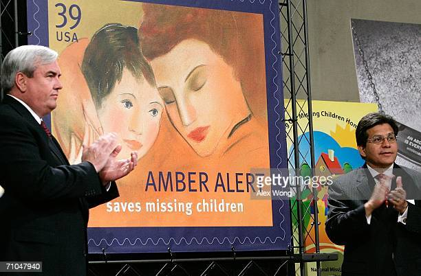 S Attorney General Alberto Gonzales and Postmaster General John Potter of the US Postal Service applaud after they unveiled the new AMBER Alert stamp...