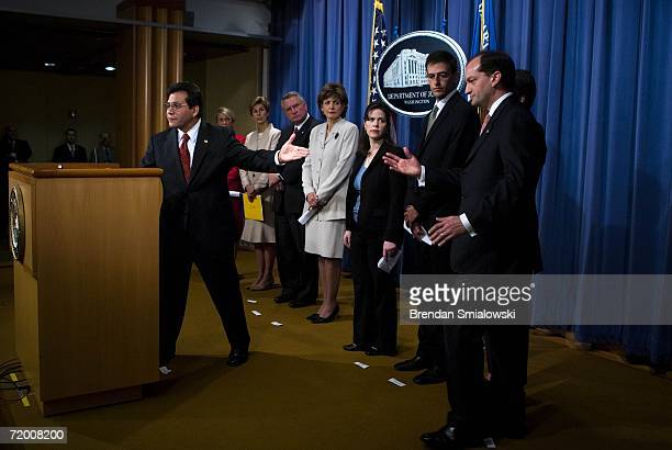 S Attorney General Alberto Gonzales gestures toward Alex Acosta US Attorney for the Southern District of Florida during a press conference at the...