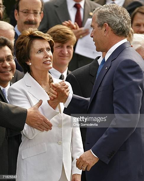 US Attorney General Alberto Gonzales House Minority Leader Nancy Pelosi Rep Patrick Kennedy and US President George W Bush congratulate one another...