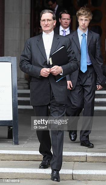 Attorney General Dominic Grieve leaves the High Court where he claimed two national newspapers published articles which were in contempt of court on...
