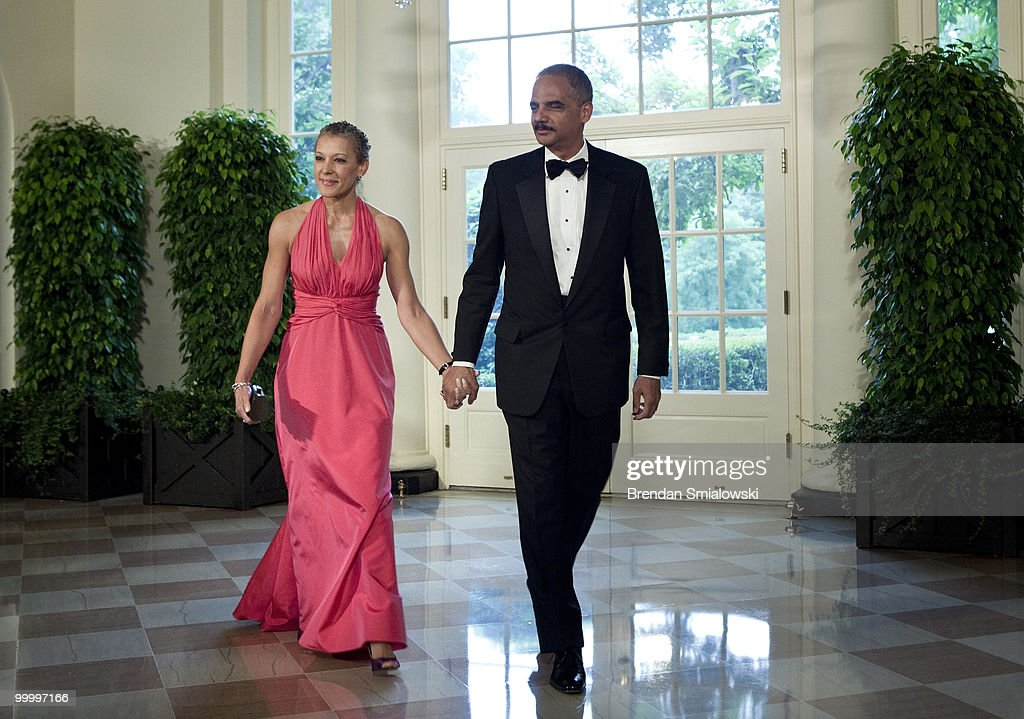 Attorney General Eric H. Holder Jr. (R) and Dr. Sharon Malone arrive at the White House for a state dinner May 19, 2010 in Washington, DC. President Barack Obama and first lady Michelle Obama are hosting Mexican President Felipe Calderon and his wife Margarita Zavala for a state dinner during their visit to the United States.
