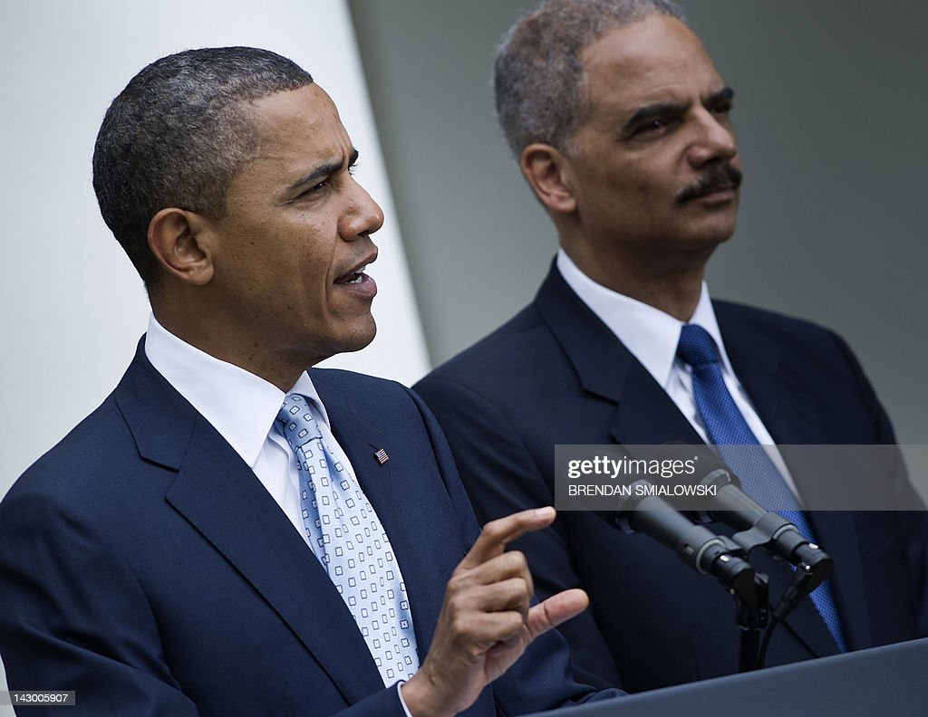 US Attorney General Eric H. Holder Jr. (R) listens while US President <a gi-track='captionPersonalityLinkClicked' href=/galleries/search?phrase=Barack+Obama&family=editorial&specificpeople=203260 ng-click='$event.stopPropagation()'>Barack Obama</a> speaks from the Rose Garden of the White House April 17, 2012 in Washington, DC. President Obama spoke about keeping oil prices low and enforcing fair pricing. AFP PHOTO/Brendan SMIALOWSKI