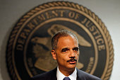 Attorney General Eric Holder addresses the media following a vote in the House of Representatives at the US Attorney's Office Eastern District of...