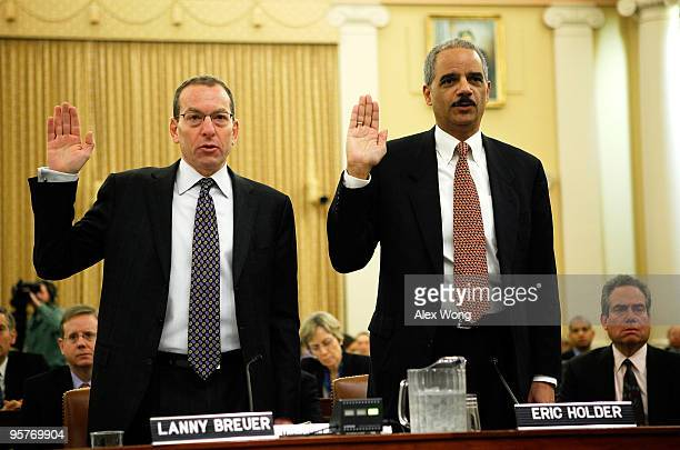 S Attorney General Eric Holder and Assistant Attorney General Lanny Breuer of the Criminal Division are sworn in during a hearing before the...