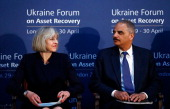 S Attorney General Eric Holder and Britain's Home Secretary Theresa May attend the opening of the Ukraine Forum on Asset Recovery at Lancaster House...