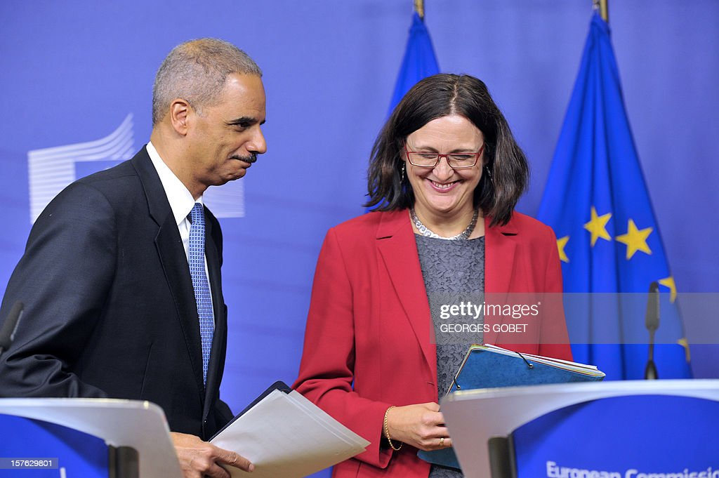 US Attorney General Eric Holder (L) and EU home affairs commissioner Cecilia Malmstroem (R) give a press conference on December 5, 2012 during the launch of a Global Alliance against child sexual abuse online, involving 45 countries, at EU headquarters in Brussels. AFP PHOTO GEORGES GOBET
