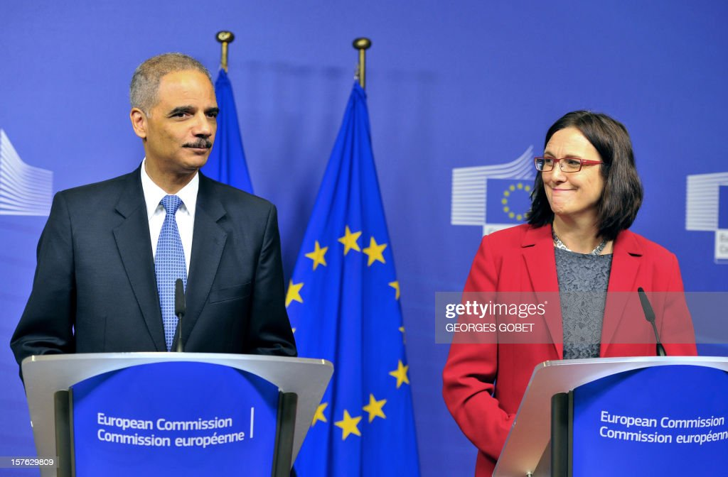 US Attorney General Eric Holder (L) and EU home affairs commissioner Cecilia Malmstroem (R) give a press conference on December 5, 2012 during the launch of a Global Alliance against child sexual abuse online, involving 45 countries, at EU headquarters in Brussels.