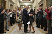 S Attorney General Eric Holder and his wife Sharon Malone say goodbye to Justice Department employees as they leaves his office on the fifth floor of...