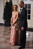 Attorney General Eric Holder and Sharon Malone arrive for the State dinner in honour of India�s Prime Minister Manmohan Singh November 24 2009 at the...