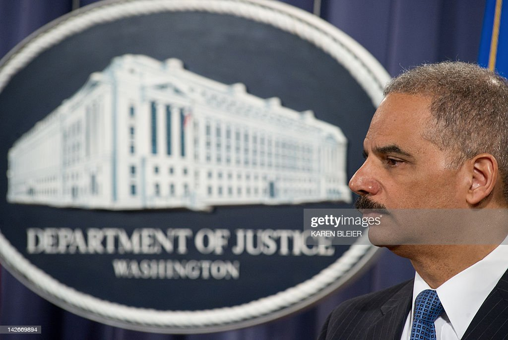US Attorney General Eric Holder announces a significant antitrust settlement on April 11, 2012 during a press conference at the Justice Department in Washington, DC. Three publishing houses reached a settlement Wednesday with US antitrust authorities after the Justice Department sued Apple and five publishers for conspiring to raise the price of e-books. Hachette Book Group, HarperCollins and Simon & Schuster reached a settlement but the case will proceed against Apple and the other two -- Macmillan and Penguin Group -- 'for conspiring to end e-book retailers' freedom to compete on price,' the Justice Department said. AFP PHOTO/Karen BLEIER