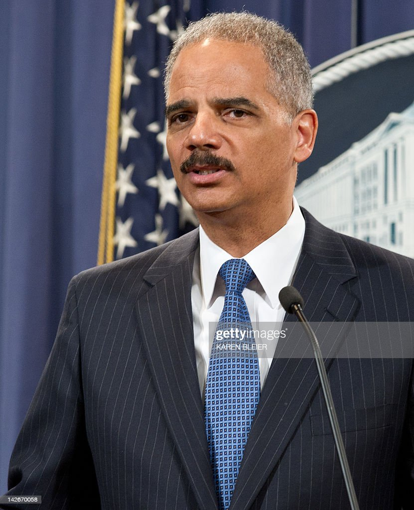 US Attorney General <a gi-track='captionPersonalityLinkClicked' href=/galleries/search?phrase=Eric+Holder&family=editorial&specificpeople=1060367 ng-click='$event.stopPropagation()'>Eric Holder</a> announces a significant antitrust settlement on April 11, 2012 during a press conference at the Justice Department in Washington, DC. Three publishing houses reached a settlement Wednesday with US antitrust authorities after the Justice Department sued Apple and five publishers for conspiring to raise the price of e-books. Hachette Book Group, HarperCollins and Simon & Schuster reached a settlement but the case will proceed against Apple and the other two -- Macmillan and Penguin Group -- 'for conspiring to end e-book retailers' freedom to compete on price,' the Justice Department said. AFP PHOTO/Karen BLEIER