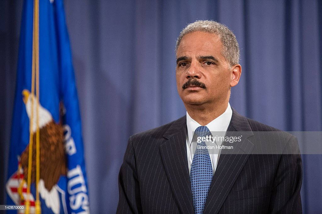 U.S. Attorney General <a gi-track='captionPersonalityLinkClicked' href=/galleries/search?phrase=Eric+Holder&family=editorial&specificpeople=1060367 ng-click='$event.stopPropagation()'>Eric Holder</a> announces an anti-trust lawsuit filed against Apple at the Department of Justice on April 11, 2012 in Washington, DC. Apple is accused of setting the price of e-books artifically high.