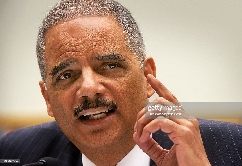 Attorney General Eric Holder answers questions as he faces the House Judiciary committee about journalists phone records and IRS improprieties, on May, 15, 2013 in Washington, DC.