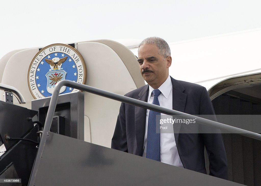 U.S. Attorney General Eric Holder arrives on US Military aircraft to Lambert-St. Louis International Airport August 20, 2014 in St. Louis, Missouri. Holder is traveling to Ferguson, Mo., to oversea the federal government's investigation into the shooting of 18-year-old Michael Brown by a police officer on Aug. 9th. Holder promised a 'fair and thorough' investigation into the fatal shooting of a young blackman, Michael Brown, who was unarmed when a white police officer shot him multiple times.