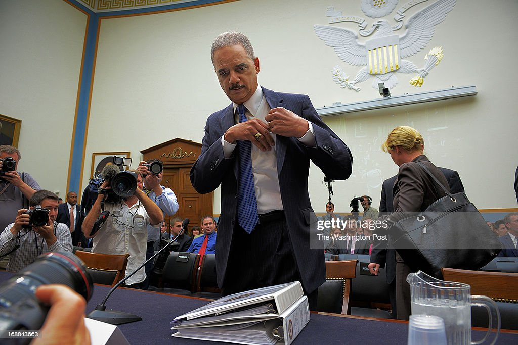 Attorney General Eric Holder arrives to face the House Judiciary committee about journalists phone records and IRS improprieties, on May, 15, 2013 in Washington, DC.