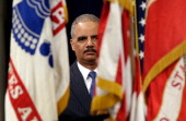 S Attorney General Eric Holder attends a naturalization ceremony at the US Department of Justice May 28 2013 in Washington DC During the event...