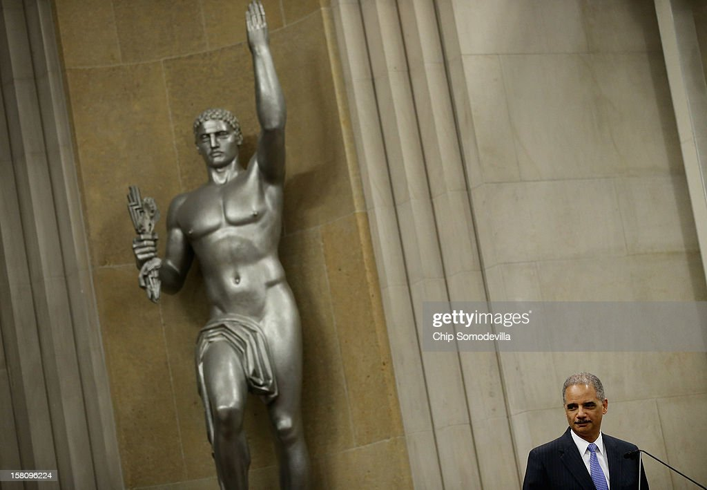 U.S. Attorney General <a gi-track='captionPersonalityLinkClicked' href=/galleries/search?phrase=Eric+Holder&family=editorial&specificpeople=1060367 ng-click='$event.stopPropagation()'>Eric Holder</a> delivers remarks during the Justice Department's Criminal Division awards ceremony at the department's headquarters December 10, 2012 in Washington, DC. Many Justice Department employees, past and present, were given awards for their outstanding public service during 2012.