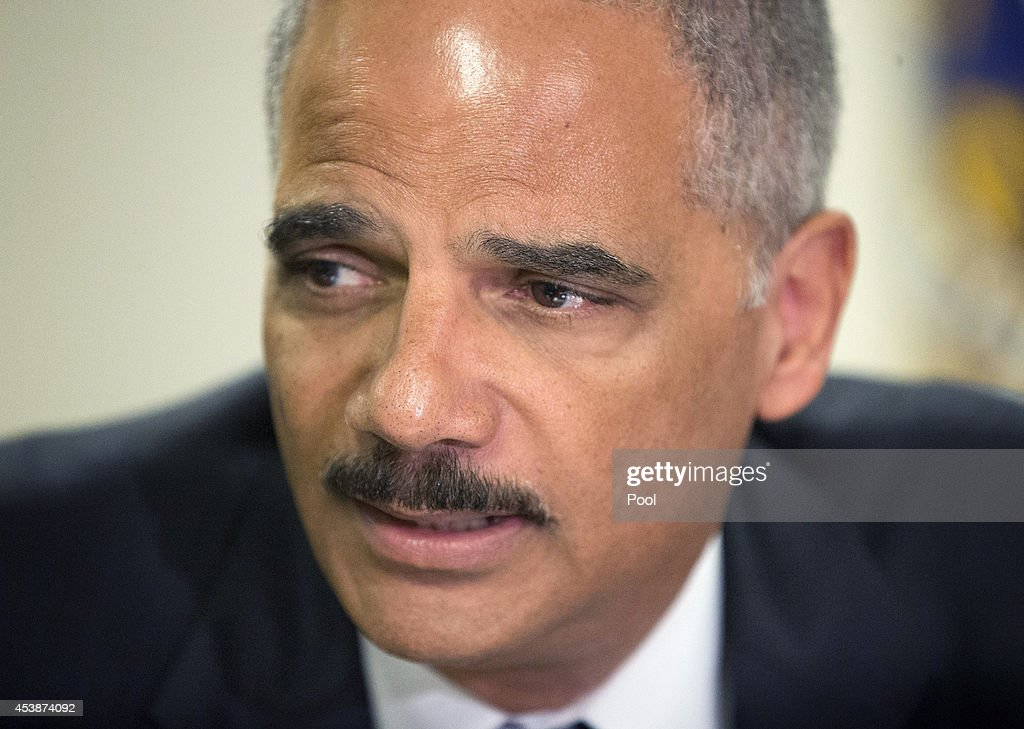 U.S. Attorney General Eric Holder during his meeting at the FBI building August 20, 2014 in St. Louis, Missouri. Holder is traveling to Ferguson, Mo., to oversea the federal government's investigation into the shooting of 18-year-old Michael Brown by a police officer on Aug. 9th. Holder promised a 'fair and thorough' investigation into the fatal shooting of a young blackman, Michael Brown, who was unarmed when a white police officer shot him multiple times.