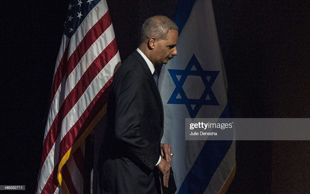 U.S. Attorney General <a gi-track='captionPersonalityLinkClicked' href=/galleries/search?phrase=Eric+Holder&family=editorial&specificpeople=1060367 ng-click='$event.stopPropagation()'>Eric Holder</a> exits the stage after delivering an address to an interfaith service for victims of Sunday's shootings on April 17, 2014 at the Jewish Community Center of Greater Kansas City, in Overland Park, Kansas. White supremacist Frazier Glenn Cross is in custody, charged with murder in the killing of two people outside the center and a third victim at a nearby Jewish retirement home on April 13.