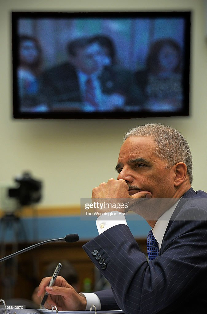 Attorney General Eric Holder faces the House Judiciary committee while listening to a tape recording provided by Rep. Darrell Issa(R-CA) on May, 15, 2013 in Washington, DC.