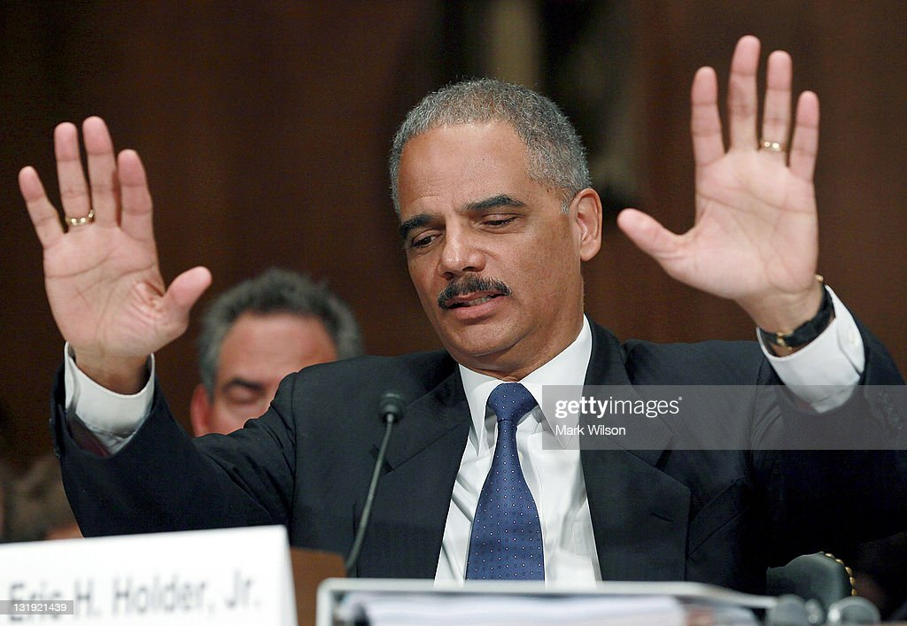 Attorney General Eric Holder gestures while answering questions during a Senate Judiciary Committee Hearing on Capitol Hill on November 8, 2011 in Washington, DC. The committee is hearing testimony from the Attorney General on the controversial 'Fast and Furious' gun-running program.