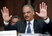 Attorney General Eric Holder gestures while answering questions during a Senate Judiciary Committee Hearing on Capitol Hill on November 8 2011 in...