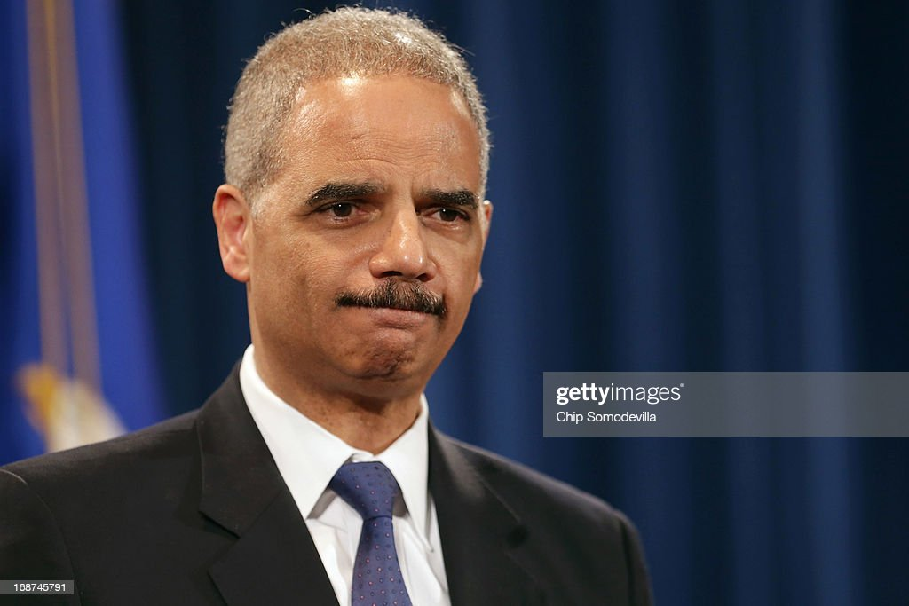 U.S. Attorney General <a gi-track='captionPersonalityLinkClicked' href=/galleries/search?phrase=Eric+Holder&family=editorial&specificpeople=1060367 ng-click='$event.stopPropagation()'>Eric Holder</a> holds a Medicare fraud news conference at which he said he recused himself last year from a national security leak probe in which prosecutors obtained the phone records of Associated Press journalists at the Justice Department May 14, 2013 in Washington, DC. Holder faced a large number of questions about his department's investigation targeting phone records and data from the Associated Press.