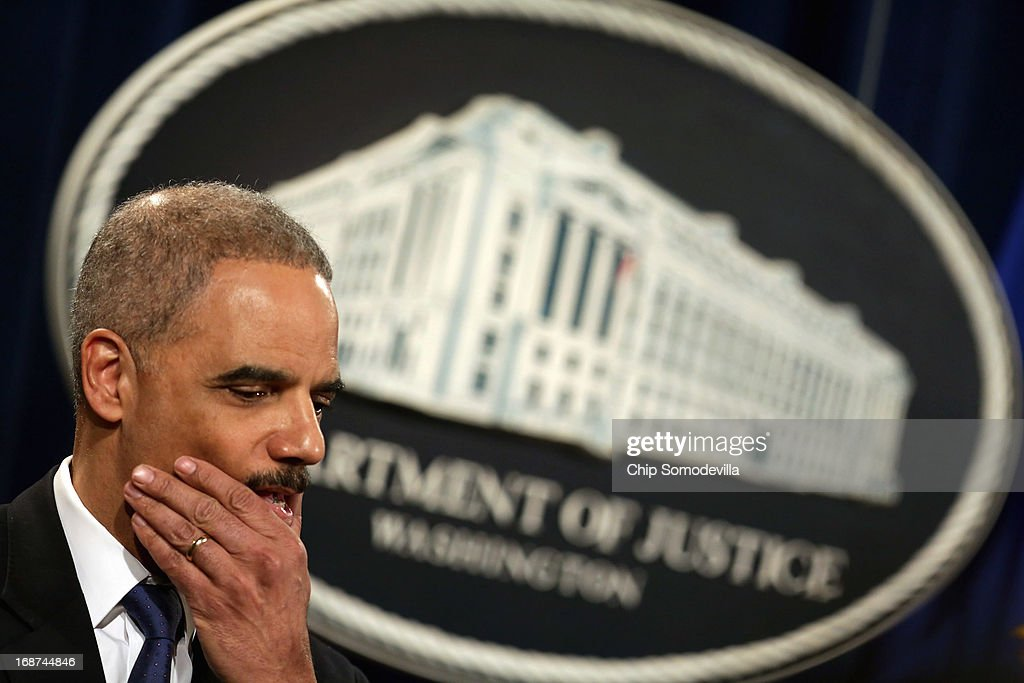 U.S. Attorney General <a gi-track='captionPersonalityLinkClicked' href=/galleries/search?phrase=Eric+Holder&family=editorial&specificpeople=1060367 ng-click='$event.stopPropagation()'>Eric Holder</a> holds a news conference about efforts by the Justice Department and the Health and Human Services Department to combat Medicare fraud at the Justice Department May 14, 2013 in Washington, DC. Holder faced a large number of questions about his department's investigation targeting phone records and data from the Associated Press.