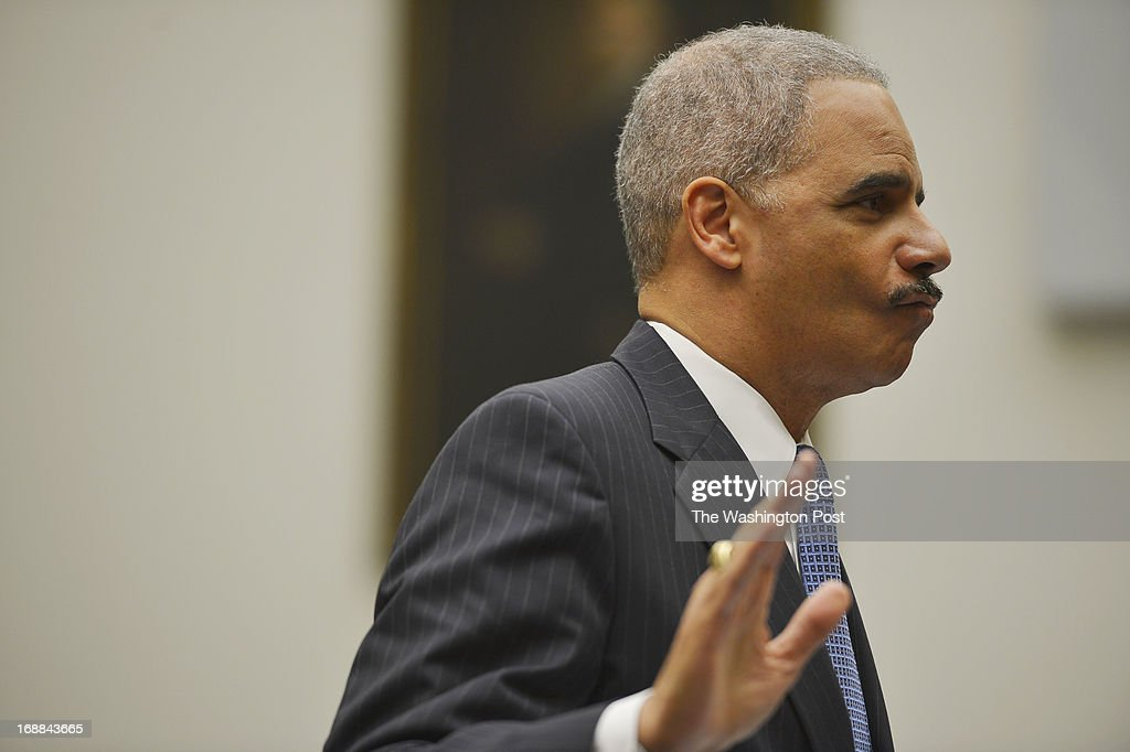 Attorney General Eric Holder is sworn in before testifying to the House Judiciary Committee at the Rayburn House Office Building on May 15, 2013 in Washington, D.C. Attorney General Eric Holder testified before the House Judiciary Committee during an oversight hearing on the U.S. Department of Justice and Holder's leadership in the department.
