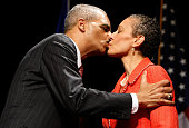 US Attorney General Eric Holder kisses his wife Dr Sharon Malone during his ceremonial installation at George Washington University March 27 2009 in...