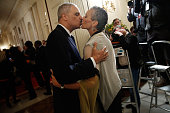 S Attorney General Eric Holder kisses his wife Sharon Malone after announcing his resignation at the White House September 25 2014 in Washington DC...