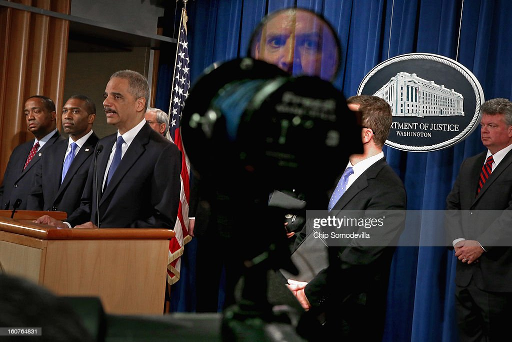 U.S. Attorney General <a gi-track='captionPersonalityLinkClicked' href=/galleries/search?phrase=Eric+Holder&family=editorial&specificpeople=1060367 ng-click='$event.stopPropagation()'>Eric Holder</a> leads a news conference with Acting Associate Attorney General Tony West, Principal Deputy Assistant Attorney General Stuart Delery and attorneys general from eight states and the District of Columbia at the Department of Justice February 5, 2013 in Washington, DC. Holder announced that the United States is bringing a civil lawsuit against the ratings agency Standards & Poor's and its parent company, McGraw-Hill Companies, over its pre-fiscal crisis bond ratings.
