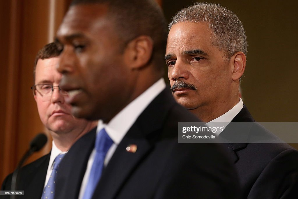 U.S. Attorney General <a gi-track='captionPersonalityLinkClicked' href=/galleries/search?phrase=Eric+Holder&family=editorial&specificpeople=1060367 ng-click='$event.stopPropagation()'>Eric Holder</a> (R) leads a news conference with Acting Associate Attorney General Tony West (C), Principal Deputy Assistant Attorney General Stuart Delery and attorneys general from eight states and the District of Columbia at the Department of Justice February 5, 2013 in Washington, DC. Holder announced that the United States is bringing a civil lawsuit against the ratings agency Standards & Poor's and its parent company, McGraw-Hill Companies, over its pre-fiscal crisis bond ratings.