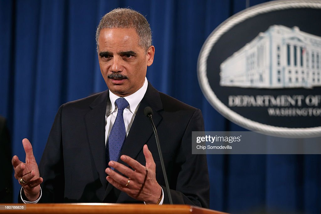 U.S. Attorney General <a gi-track='captionPersonalityLinkClicked' href=/galleries/search?phrase=Eric+Holder&family=editorial&specificpeople=1060367 ng-click='$event.stopPropagation()'>Eric Holder</a> leads a news conference with attorneys general from eight states and the District of Columbia at the Department of Justice February 5, 2013 in Washington, DC. Holder announced that the United States is bringing a civil lawsuit against the ratings agency Standards & Poor's and its parent company, McGraw-Hill Companies, over its pre-fiscal crisis bond ratings.