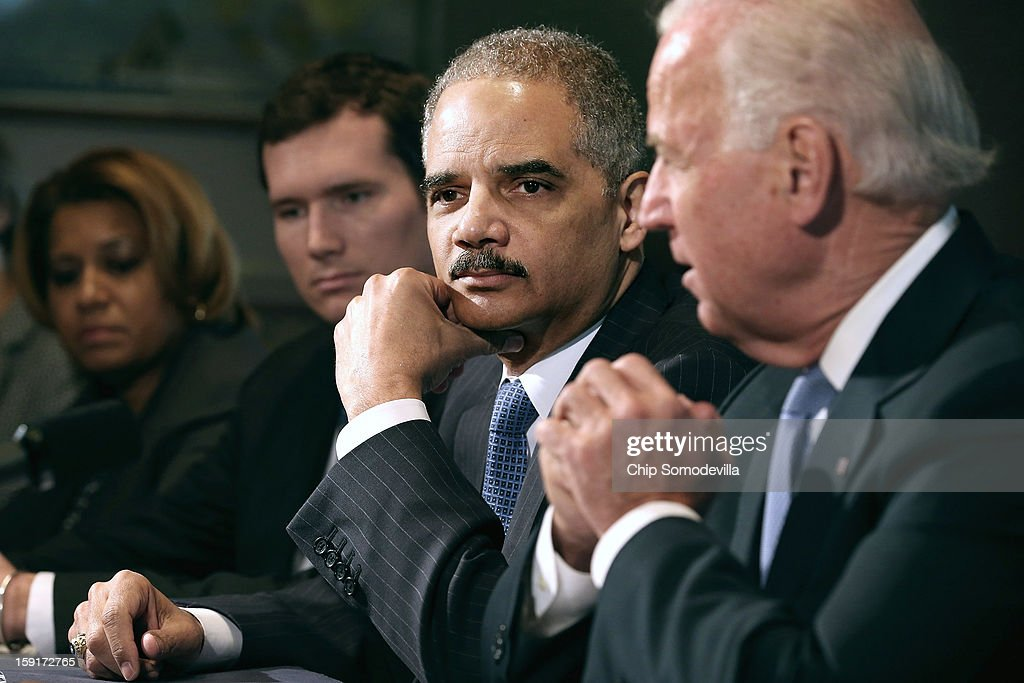 U.S. Attorney General <a gi-track='captionPersonalityLinkClicked' href=/galleries/search?phrase=Eric+Holder&family=editorial&specificpeople=1060367 ng-click='$event.stopPropagation()'>Eric Holder</a> (2nd R) listens as Vice President Joe Biden (R) makes brief remarks to the press at the beginning of a meeting with and gun violence survivors and victims and gun safety advocacy groups in the Eisenhower Executive Office Building January 9, 2013 in Washington, DC. President Barack Obama appointed Biden to oversee a task force on gun violence.