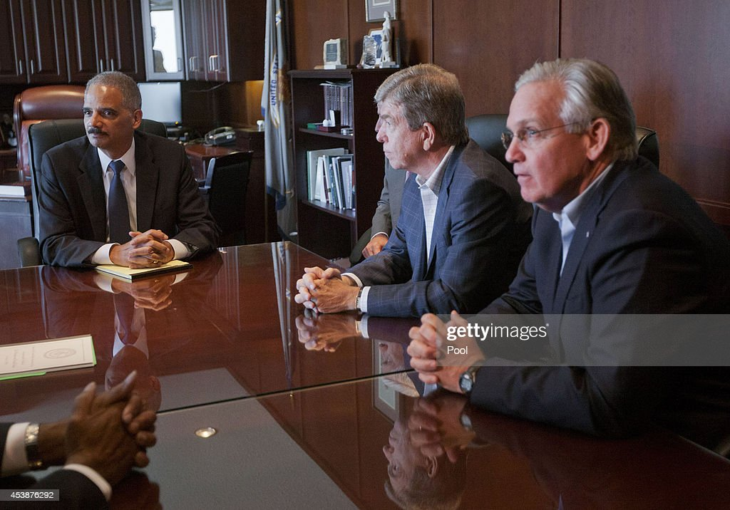 U.S. Attorney General Eric Holder (L) meets with U.S. Sen. Roy Blunt, (R-MO) (C) and Missouri Gov. Jay Nixon at the U.S. Attorney's office August 20, 2014 in St. Louis, Missouri. Holder is in the area to oversee the federal government's investigation into the shooting of unarmed 18-year-old Michael Brown by a police officer on August 9.