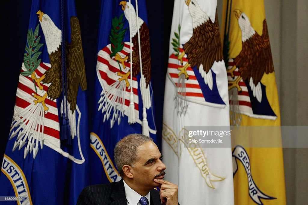 U.S. Attorney General <a gi-track='captionPersonalityLinkClicked' href=/galleries/search?phrase=Eric+Holder&family=editorial&specificpeople=1060367 ng-click='$event.stopPropagation()'>Eric Holder</a> participates in the Justice Department's Criminal Division awards ceremony at the Robert F. Kennedy Main Justice Building December 10, 2012 in Washington, DC. Many Justice Department employees, past and present, were given awards for their outstanding public service during 2012.