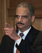 US Attorney General Eric Holder points to a reporter during a question and answer after being swornin by US Vice President Joe Biden on February 3 at...