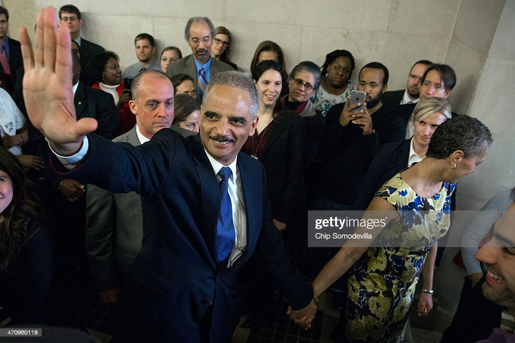 U.S. Attorney General <a gi-track='captionPersonalityLinkClicked' href=/galleries/search?phrase=Eric+Holder&family=editorial&specificpeople=1060367 ng-click='$event.stopPropagation()'>Eric Holder</a> says goodbye to Justice Department employees as he leaves the Robert F. Kennedy building with his wife April 24, 2015 in Washington, DC. The first African American attorney general in U.S. history, Holder is leaving his post as the country's highest ranking law enforcement official after six years on the job and will be succeeded by Loretta Lynch.