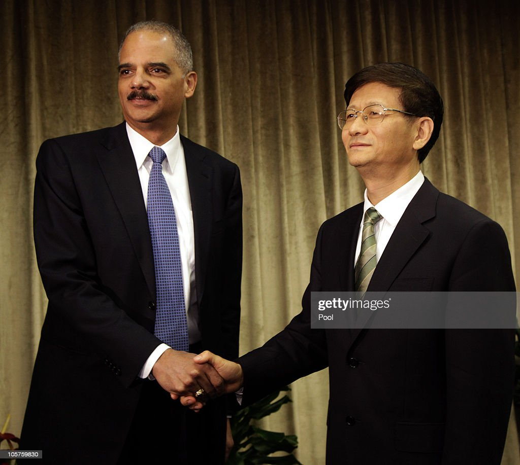 U.S. Attorney General Eric Holder (L) shakes hand with Chinese Minister of Public Security Meng Jianzhu during a meeting at the Ministry of Public Security on October 20, 2010 in Beijing, China. Holder urged China to release the Nobel Peace prize winner Liu Xiaobo, who is currently serving an 11-year prison sentence on the charges of inciting subversion of state power, ahead of his three day visit to Beijing.