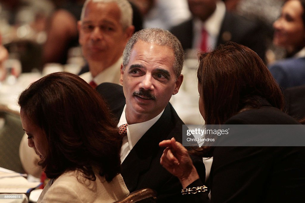 U.S. Attorney General <a gi-track='captionPersonalityLinkClicked' href=/galleries/search?phrase=Eric+Holder&family=editorial&specificpeople=1060367 ng-click='$event.stopPropagation()'>Eric Holder</a> (C) sits in the audience at the Clarence M. Mitchell Jr. Memorial Lecture Luncheon at the NAACP Centennial Convention July 13, 2009 in New York City. Holder addressed a group of prominent black lawyers during the luncheon, part of the National Association for the Advancement of Colored People's 100th anniversary convention.