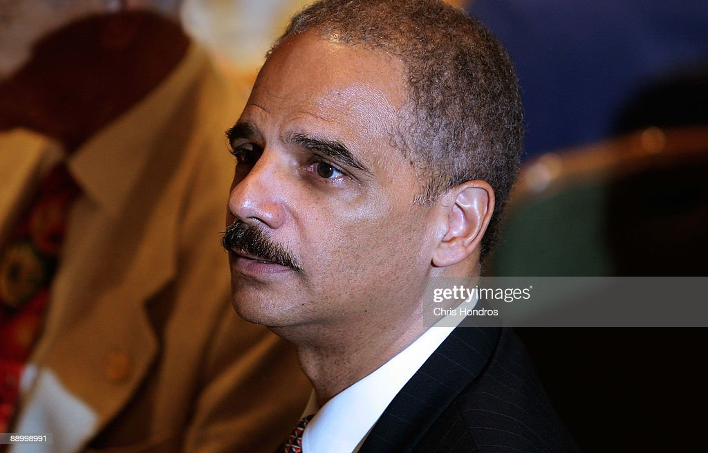 U.S. Attorney General <a gi-track='captionPersonalityLinkClicked' href=/galleries/search?phrase=Eric+Holder&family=editorial&specificpeople=1060367 ng-click='$event.stopPropagation()'>Eric Holder</a> sits in the audience at the Clarence M. Mitchell Jr. Memorial Lecture Luncheon at the NAACP Centennial Convention July 13, 2009 in New York City. Holder addressed a group of prominent black lawyers during the luncheon, part of the National Association for the Advancement of Colored People's 100th anniversary convention.
