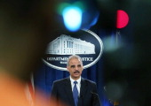Attorney General Eric Holder speaks about distressed homeowners during a news conference at the Justice Department on October 9 2012 in Washington DC...