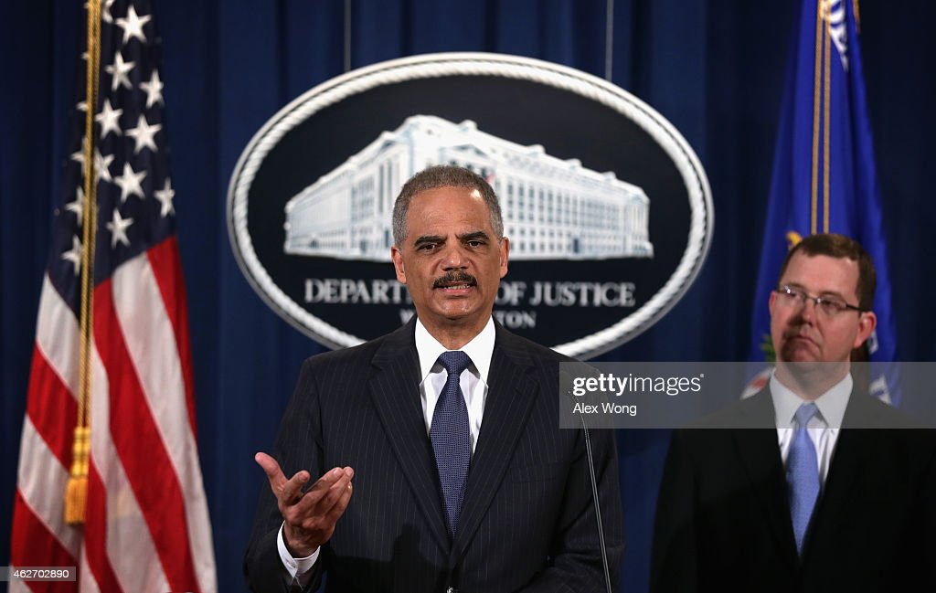 U.S. Attorney General Eric Holder (L) speaks as Acting Associate Attorney General Stuart Delery (R) looks on during a news conference to make a major financial fraud announcement February 3, 2015 at the Justice Department in Washington, DC. Rating agency S&P has agreed to pay a $1.37 billion fine to settle charges from the Justice Department and 19 state attorneys general and the District of Columbia 'to resolve allegations that S&P had engaged in a scheme to defraud investors in structured financial products known as Residential Mortgage-Backed Securities (RMBS) and Collateralized Debt Obligations (CDOs).'